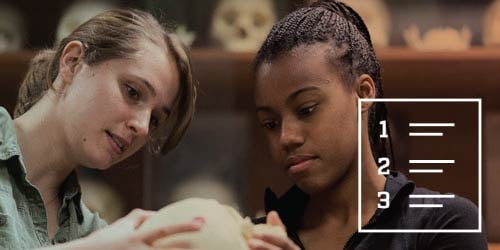 Two female UF students studying a skull in an anthropology class